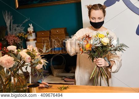 Florist Works With Colors. Flower Seller Chooses Flowers For Future Bouquet. Flowers Shop Worker In