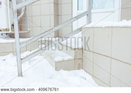 Steps In The Snow. A Dangerous Place. Sliding Steps