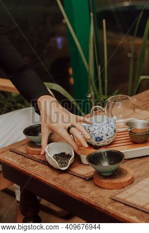Woman Serving Chinese Tea In A Tea Ceremony