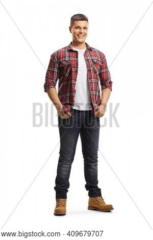 Full length portrait of a smiling young man in shirt and jeans posing isolated on white background
