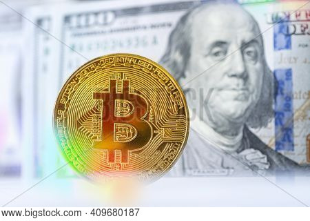 Golden Bitcoin With Benjamin Franklin Portrait From One Hundred American Dollars. Business Concept O