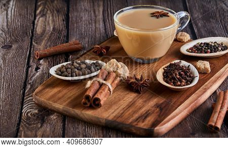 Masala Tea. Flavoured Tea Chai. Traditional Indian Hot Drink With Various On A Wooden Board In A Por