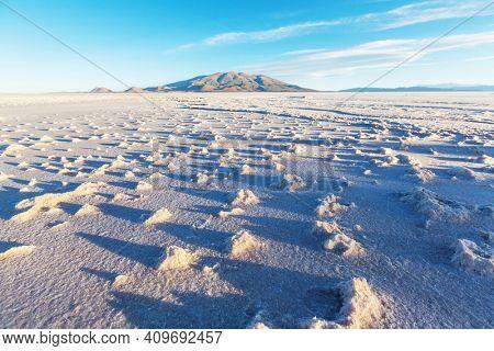 Landscape of the Uyuni Salt Flats at sunrise, Bolivia. Unusual natural background