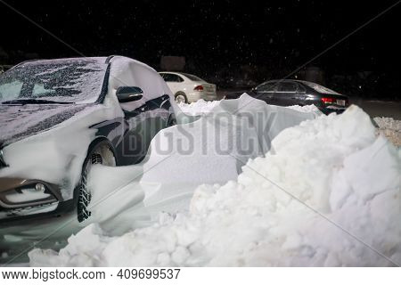 Car On The Street At Night Is Blocked By A Large Amount Of Snow, Leaving Is Impossible. Concept Of L