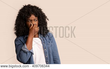 Portrait Of Black Woman Closing Nose With Fingers, Feeling Unpleasant Scent, African American Lady S