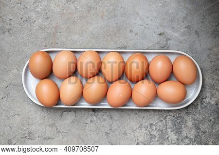 Fresh And Hygienic Chicken Eggs Ready For Cooking. Concept Of Culinary Class In A Kitchen. View From