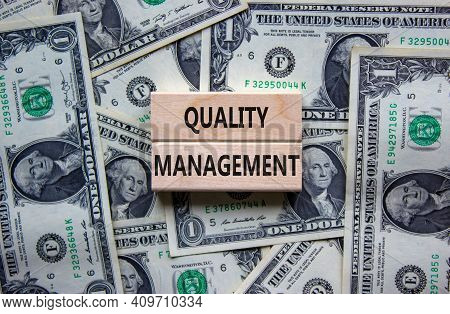 Quality Management Symbol. Concept Words 'quality Management' On Wooden Blocks On A Beautiful Backgr