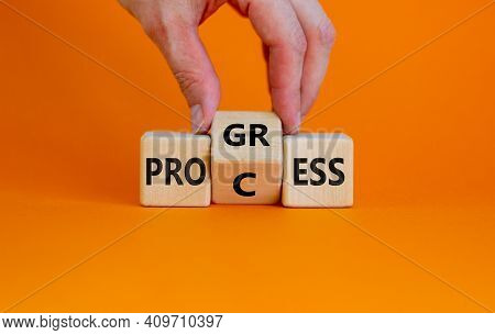 Process And Progress Symbol. Businessman Turns A Wooden Cube And Changes The Word 'process' To 'prog