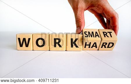Work Hard Or Smart Symbol. Businessman Turns Wooden Cubes And Changes Words 'work Hard' To 'work Sma