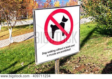 Warning  Sign: Dog Walking Without A Leash And A Muzzle Are Prohibited