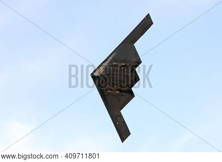 Modern Air Force Stealth Bomber In Flight Against Clear Sky