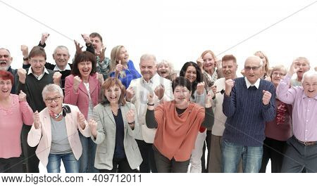 Group of senior people raising their hands celebrating a victory