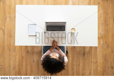 Overhead View Of African American Woman Or Female Office Worker With Curly Hair Sitting At The Moder