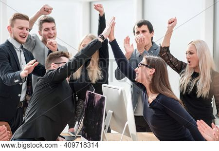 happy business team with a gesture of showing their success