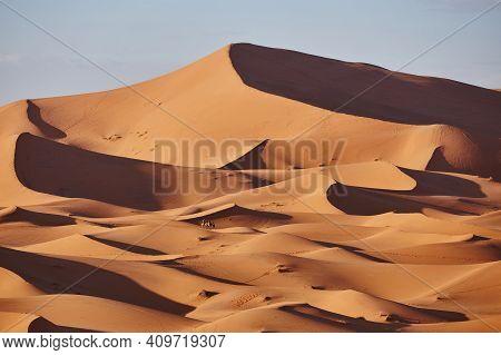 Endless Sands Of The Sahara Desert. Beautiful Sunset Over Sand Dunes Of Sahara Desert Morocco Africa