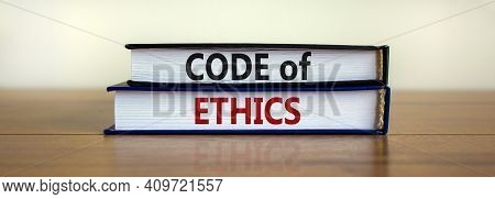 Code Of Ethics Symbol. Concept Words 'code Of Ethics' On Books On A Beautiful Wooden Table, White Ba