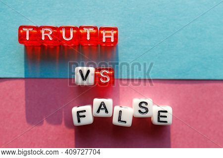 The Words Truth And Lie Are Made Up Of Cubes On Different Colored Backgrounds. Confrontation Between
