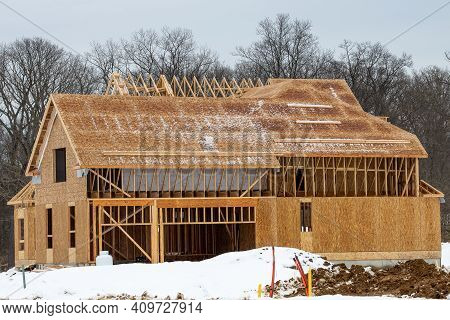 Winter Construction Of A Plywood House Frame Work Roof