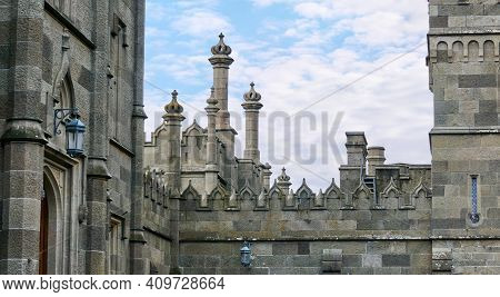 Walls And Towers Of An Ancient Palace Stylized As A Medieval Castle