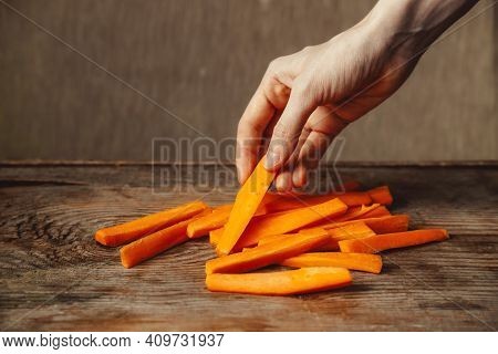 A Good Snack. Vegetable Snacks. Carrot Snacks. Healthy Food. Vitamin A. Pieces Of Carrots On A Woode