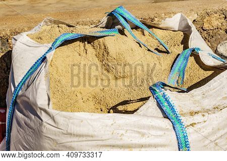 Construction Works Area With Big Bag Of Sand.