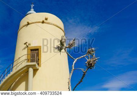 Dry Plant And Carbonera Lighthouse On Punta Mala, La Alcaidesa, Spain. Lantern Overlooks The Strait