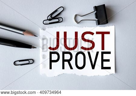 Just Prove. Text On White Paper On Gray Background