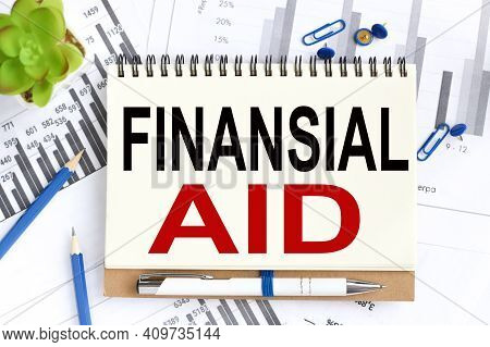 Financial Aid. Text On White Notepad Paper On Light Background