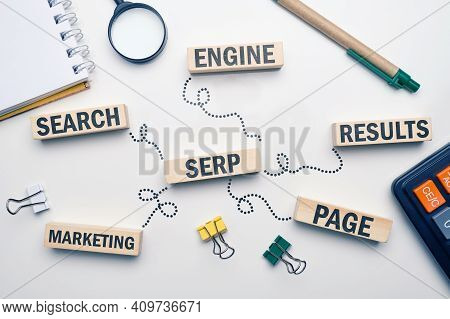 Marketing Buzzword Serp. Term Search Engine Results Page On Wooden Blocks.