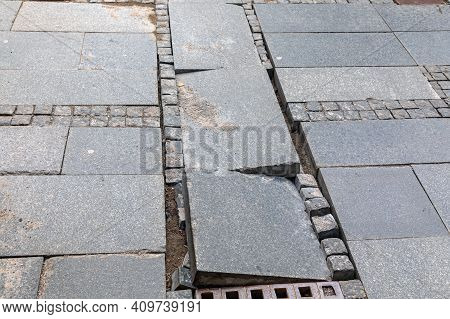 Damaged Pavement Tiles And Cobblestones At City Street