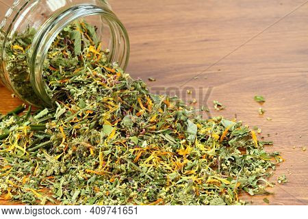 Various Dried Herbs, Alternative Medicine. Healing Herbs In A Glass On The Brown Wooden Table, Copy