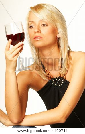 Blond Girl With Glass Of Wine