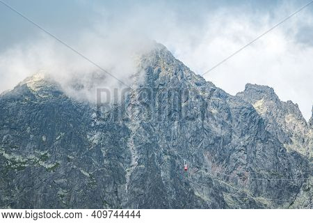 View Of The Lomnicky Stit Peak, Famous Rocky Summit In High Tatras, Slovakia. Cloudy Windy Day.