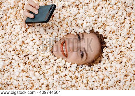 Girl Portrait In Popcorn. Image Of Beautiful European Woman 20S Eating Popcorn. Eating Popcorn.young