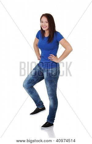 Happy casual woman with one leg up , like she want to  smash something.