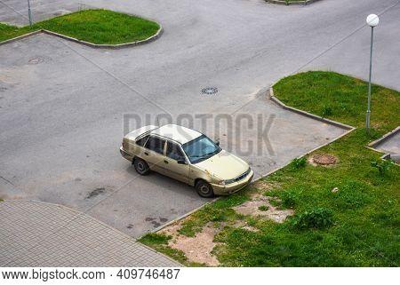 Old rustic car parked in the yard at Saint-Peterburg city