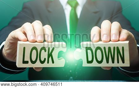 A Man Breaks Apart Puzzles With The Word Lockdown. The End Of The Period Of Strict Quarantine Measur