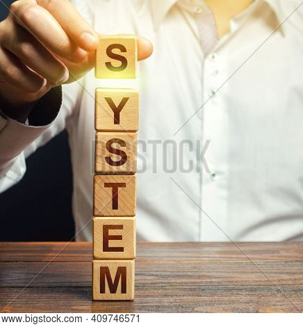 The Man Builds A Tower Of Blocks The Word System. Creation Of A System, Organization Of Processes, S
