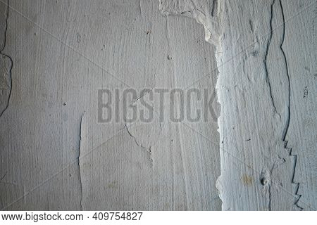Crack. Texture Of Old Painted White Plaster. Cracked Wall. White Wall With Cracks. Old White Cracked