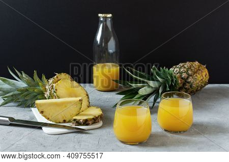 Pineapple Fresh Juice In Glass On Grey Table Over Black Background. Fresh Vitamins Pineapple Juice.