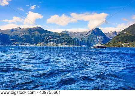 Norwegian Landscape. Mountains And Fjord With Ferry Boat.