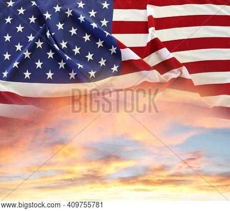 American flag in sunny sky