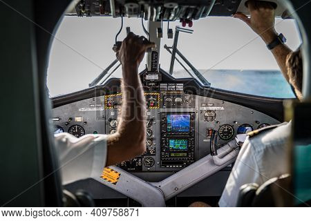December.09.2019: Noonu Atoll, Maldives: Pilot And Copilot In Commercial Plane In Cockpit, Pilot Ope