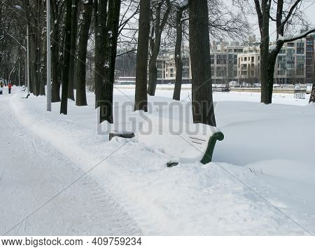 Bod Bench With A Large Snowdrift In The Park