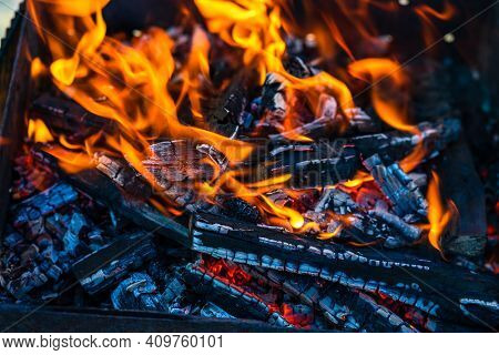 Burning Wood Chips To Form Coal. Barbecue Preparation, Fire Before Cooking.