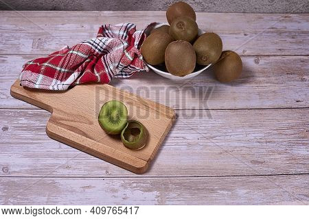 Kiwifruit In White Bowl And Wooden Board, Wooden Floor, Kitchen Towel, Checkered, Warm Red Tones, Sp