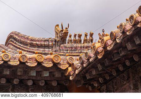 Beijing, China - April 27, 2010: Forbidden City. Closeup Of Row Of Animal Sculptures On Ridge Of Roo