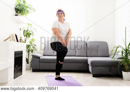 Fit Happy Senior Woman Doing Stretching Exercises On Her Yoga Mat