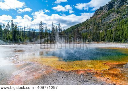 Classic Rainbow Thermal Pool At The Famous Yellowstone National Park