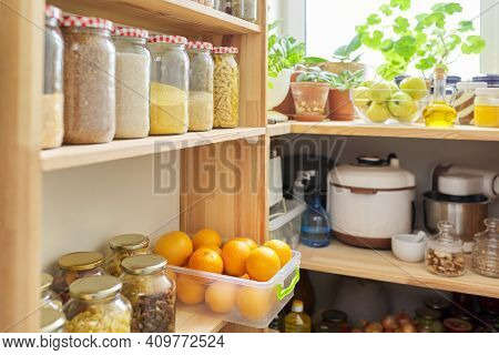 Kitchen Pantry, Wooden Shelves With Jars And Containers With Food, Food Storage. Jars Of Cereals, Co